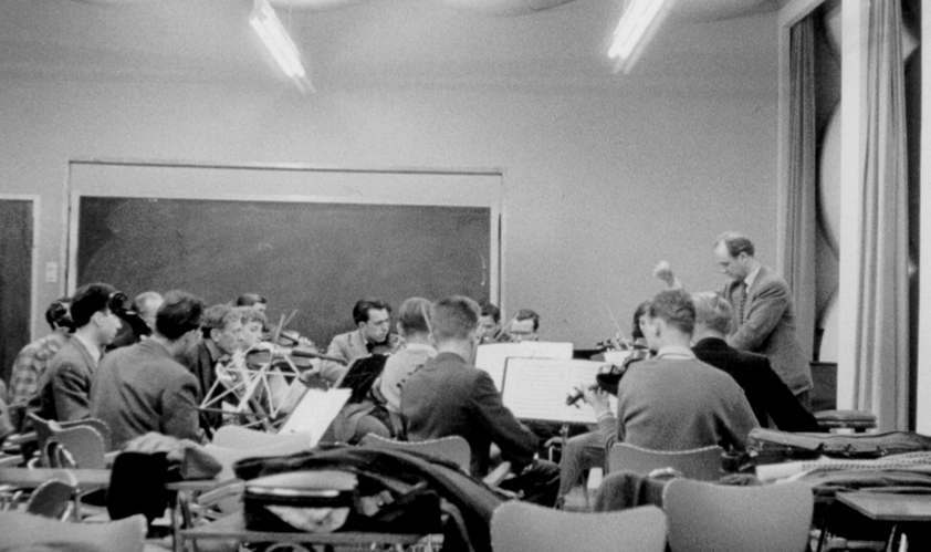 Black and white photo of a small ensemble during orchestra rehearsal
